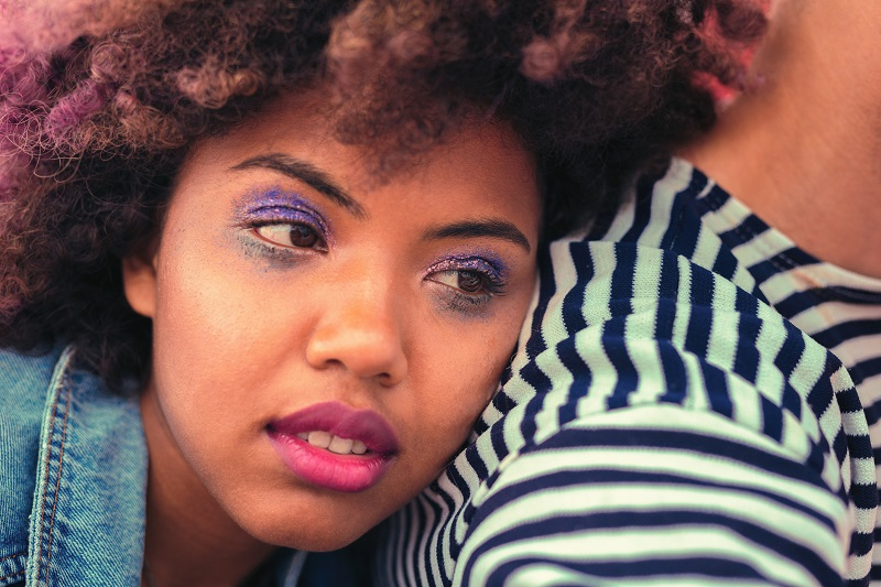 Blue eye shadows. Calm sleepy young girl with blue eye shadows feeling unwell after a long party