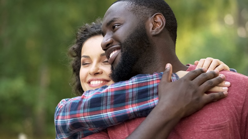 Beautiful multiethnic couple loving each other, family creation, happiness