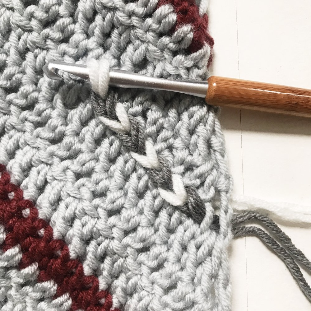 Continue in this manner, alternating colors C and D to form the braid.