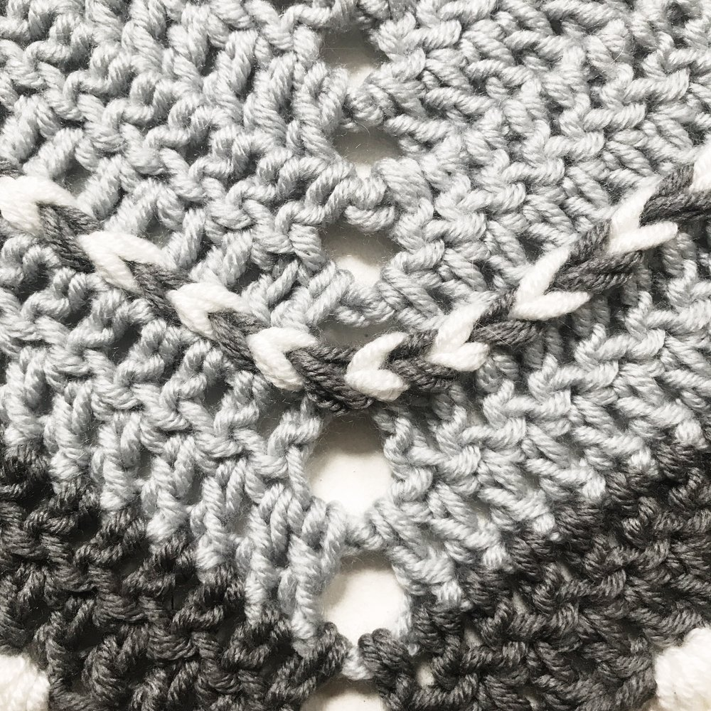 At the center ch-3 sp, work into each chain as if it were a stitch to maintain the braid.