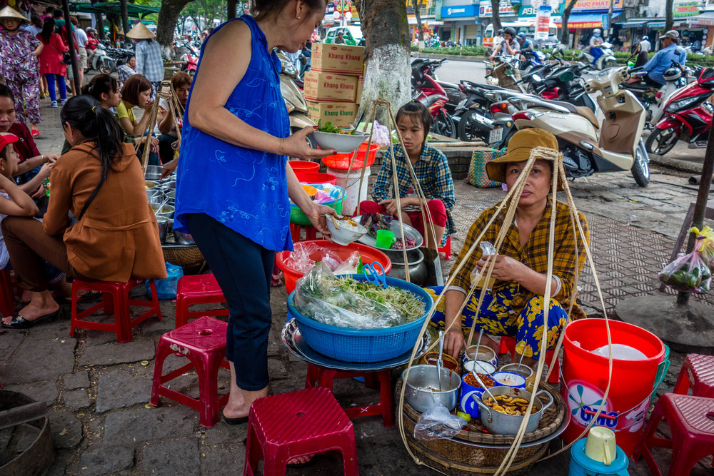 Soup ladies outside the market in Hue, Vietnam