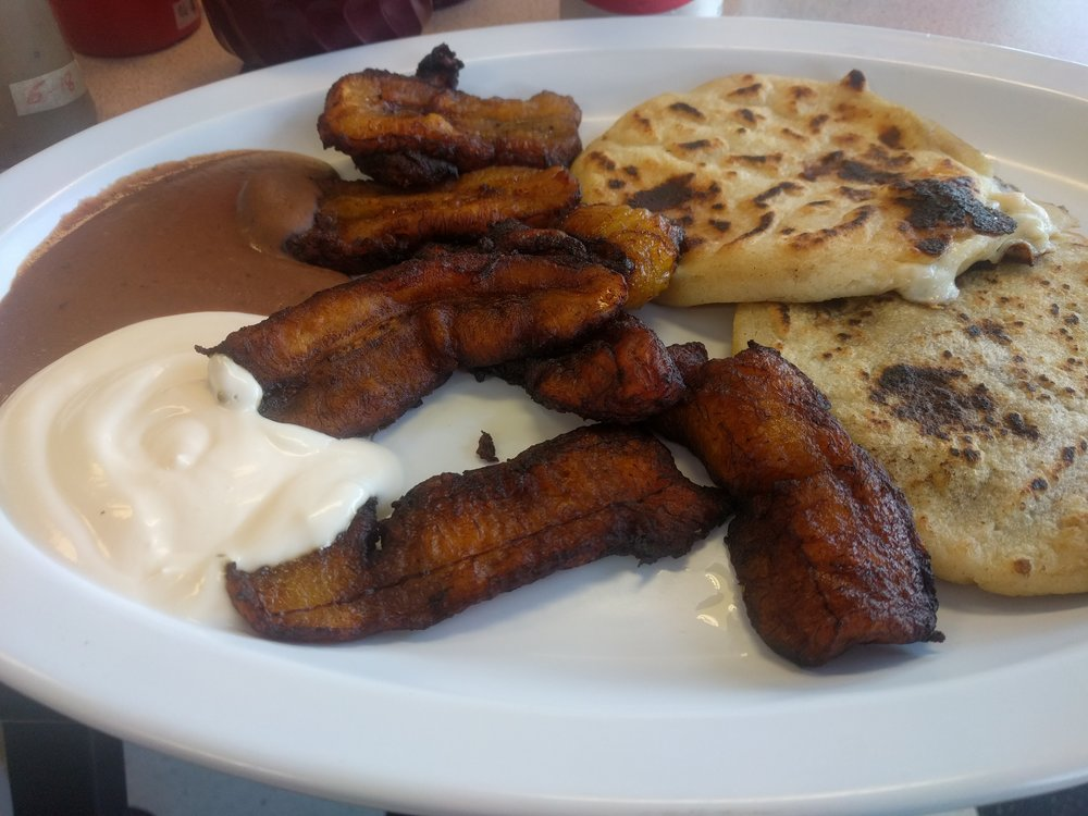 Pupusas with fried plantains, refried beans, and crema.