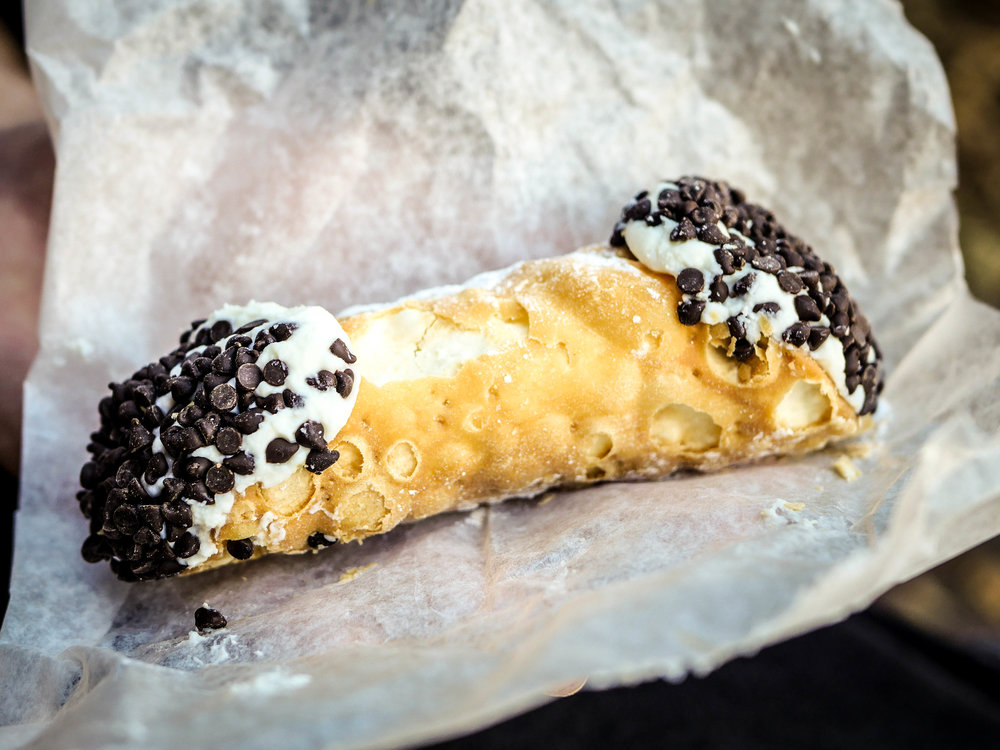 A chocolate chip cannoli from Mike's Pastry in Boston's North End. Absolutely worth the waiting madness.