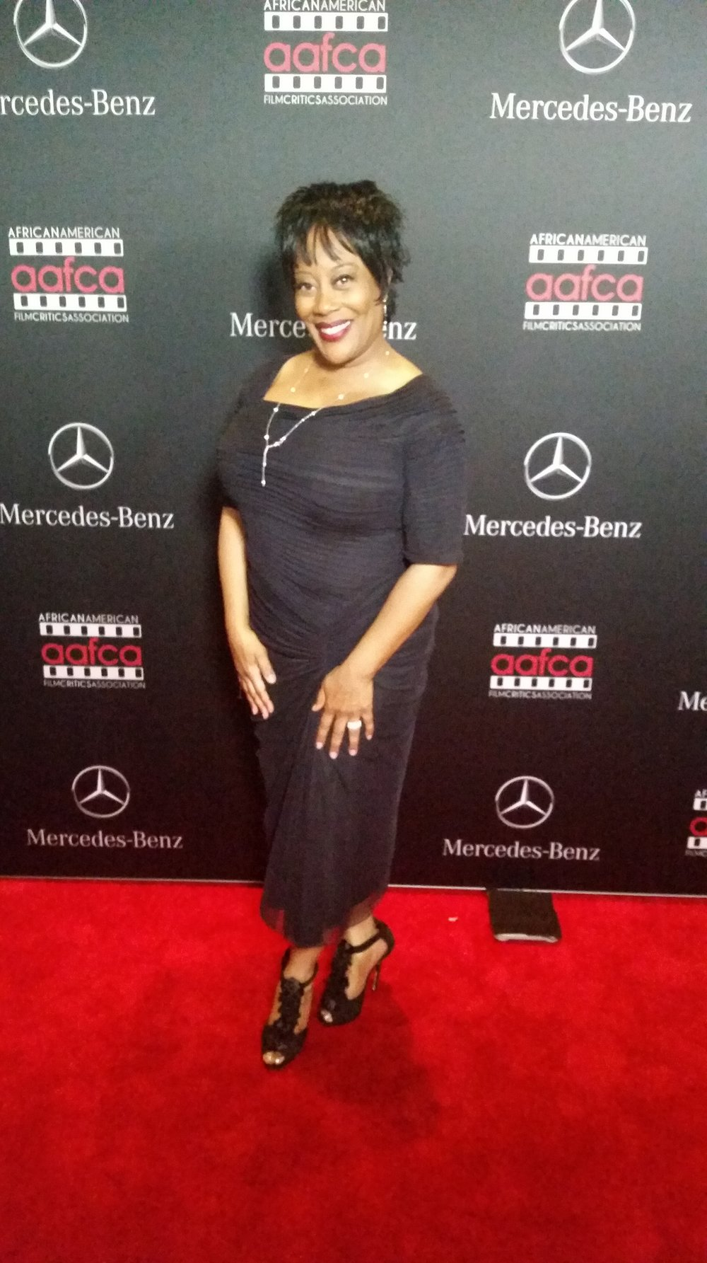 carla renata on the red carpet at the aafca oscar screening party