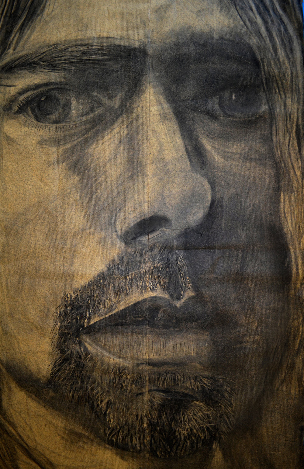 Charcoal portrait of Kurt Cobain on parchment paper. The piece is 20 ft. tall and 6 ft. wide