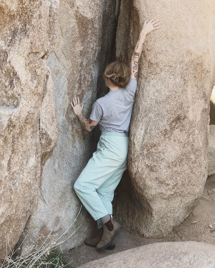 Climbing boulders in Joshua Tree