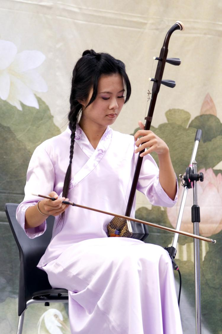 A woman plays the Erhu