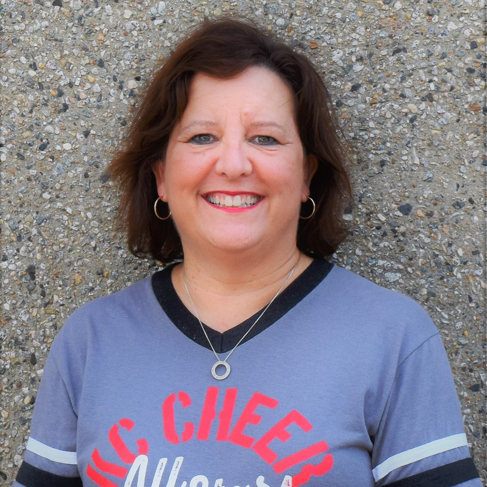 "Christi Gottschalk   Special Athlete Program Manager  Christi has a degree in Elementary Education and a minor in Art, and earned a Master's in Education from Friends University and a Leadership Certification from Baker University. Christi taught elementary school for 10 years and has been an elementary principal for more 10 years in the Olathe School District, where she currently works today. She has many years of experience with children with special needs and is very excited to be a part of the Firecracker team!   Contact Christi     ""My daughter Claire joined the KC Cheer family last year and all the coaches and families have been very welcoming. The coaches want the best the for all the athletes in the gym. I love cheer and want to share the excitement of performing with all children who want to experience it!"""