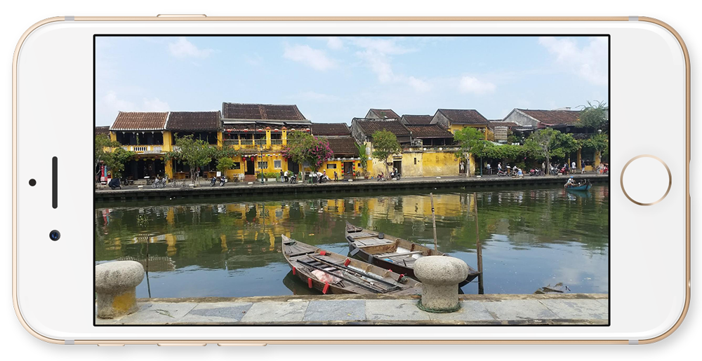 The view from our favourite cafe, across the river in Hoi An.
