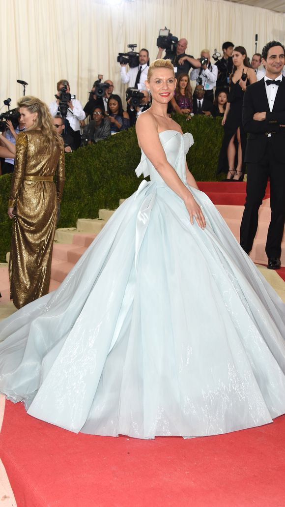 Claire Danes' pale blue dress was designed by Zac Posen, who's standing behind the actress. (Photo: Jamie McCarthy, FilmMagic)