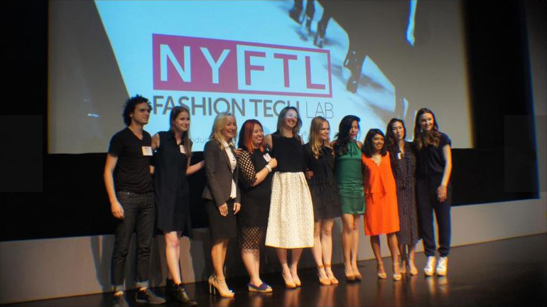 New York Fashion Tech Lab grads gather on stage after the Demo Day graduation. Teresa Novellino