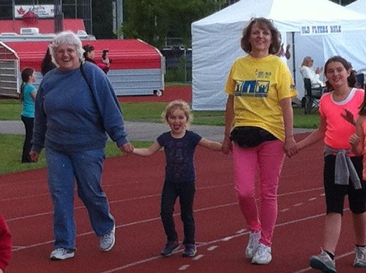 Millie celebrating surviving stomach cancer with her family at the Relay for Life