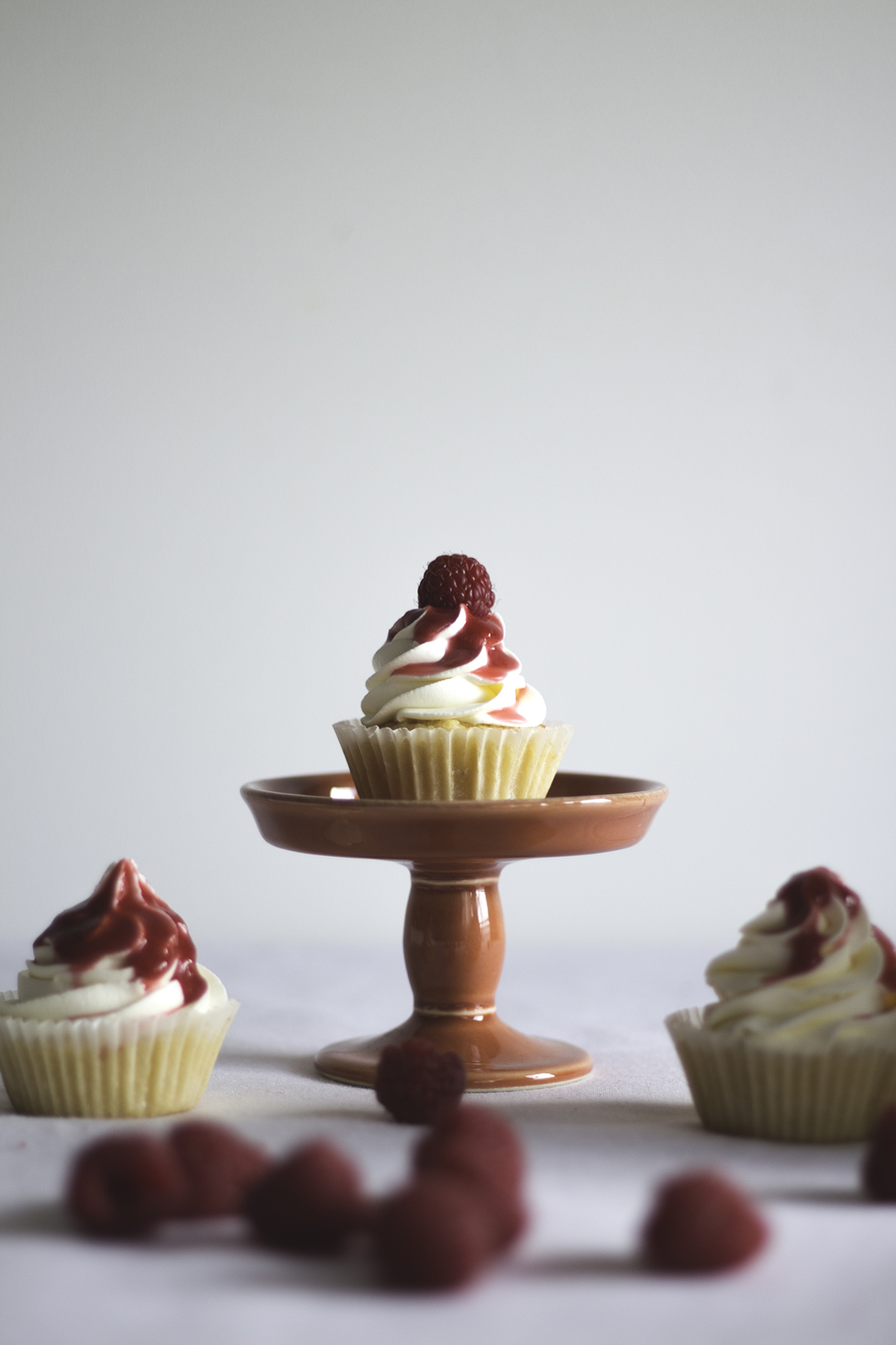 orange cupcakes raspberry coulis7
