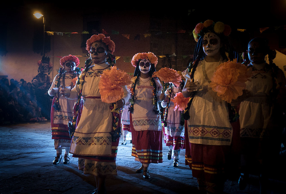 Young girls dressed as catrinas perform a folk dance at the La Calaca Festival in San Miguel de Allende.  One of the highlights of the festival, which celebrates Dia de Muertos, is the Ballet Folklórica, an exhibition of regional folk dances from across Mexico.