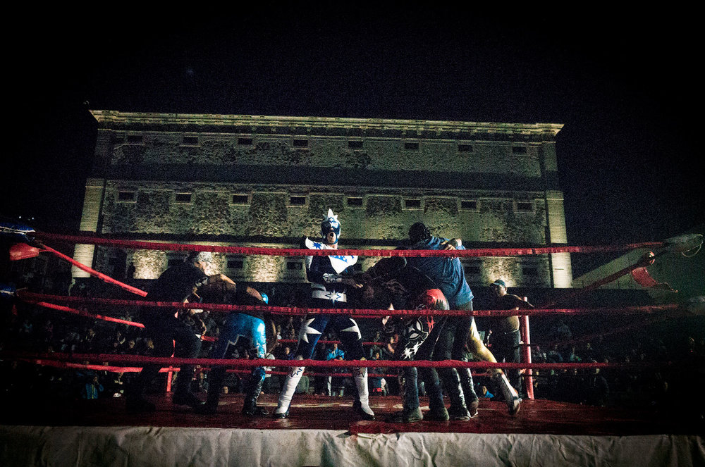 An amateur lucha libre match takes place despite the rain on a Saturday night in Guanajuato.