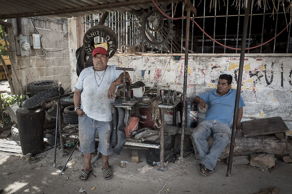 One of the many vulcanizadoras (tire repairers) in Mexico.  Salvador repairs anywhere from six to twelve tires per day.  The dust and disorder of his workstation is misleading; in truth, he works with the efficiency and accuracy that would hold par with any master craftsman.