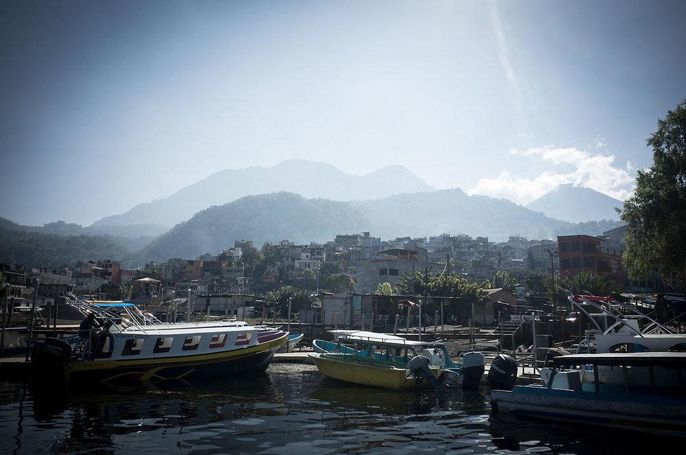 Morning haze blurs the volcanic hills behind the lakeside village of Santiago Atitlan.