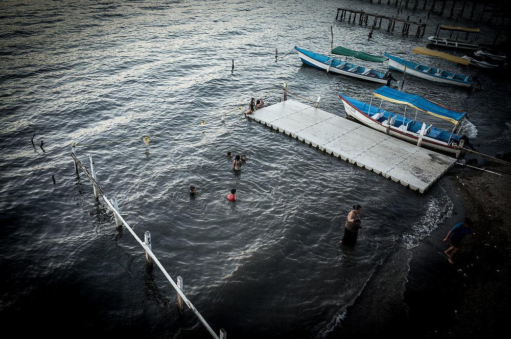 Visitors bathe in the Lago de Coatepeque, El Salvador.