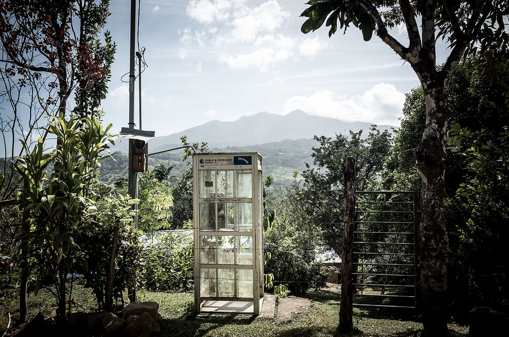 A phone booth sits along a dirt road in the mountains of Sante Fe, Panama.