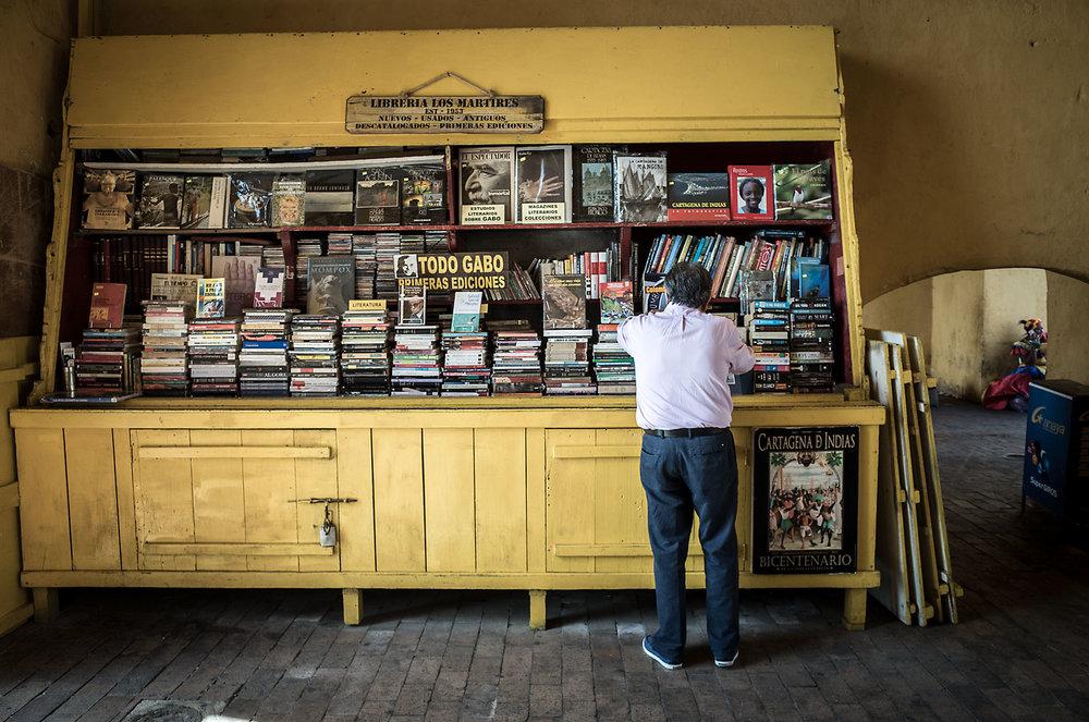 A man peruses used titles at the Librería Los Martires bookshop under the clocktower in Cartagena.