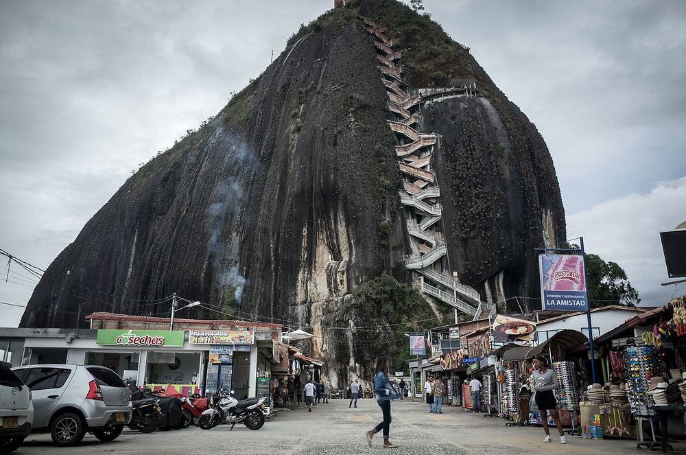 Tourists shops surround the base of El Peñón de Guatapé, a 200m high monolith that crowns the surrounding lake.  Visitors can climb a series of zig-zagging stairs to the top, where souvenir shops and beautiful views await them.