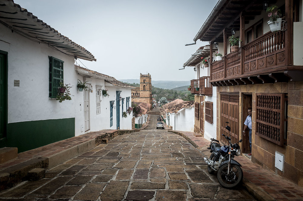 Immaculate stone streets and white buildings with colorful trim define the aesthetic of Barichara, a colonial town in Santander Department, Colombia.