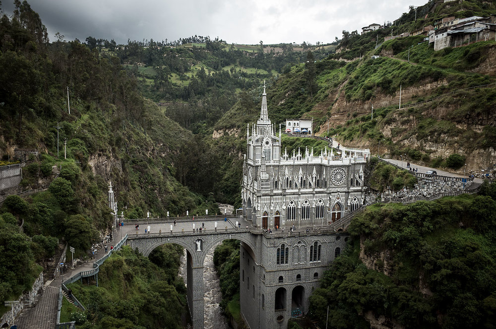 Though it was built in a traditional gothic style, the basilica at Santuario de Las Lajas (Colombia) was actually constructed in the first half of the 20th century, replacing a shrine that sanctified a 18th century Marian vision in the canyon.  The construction spans the steep canyon walls of Guáitara River, which roars 40m below.