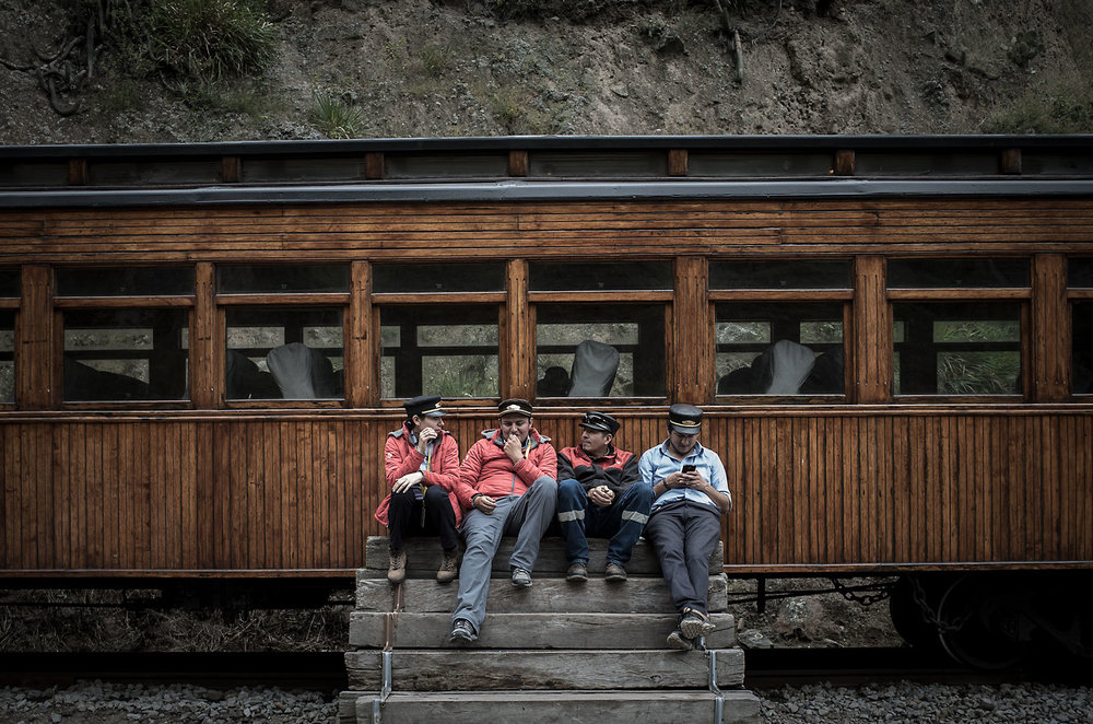 Train workers take a break in Sibambe, Ecuador.