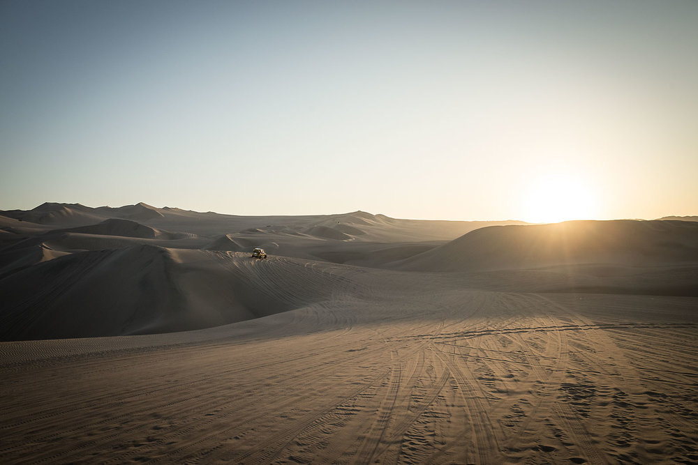 A dune buggy plays in the sand dunes that surround Huacachina on the southern coast of Peru.  Every January, motorcycles and trucks pass through the area as part of the annual Dakar Rally.