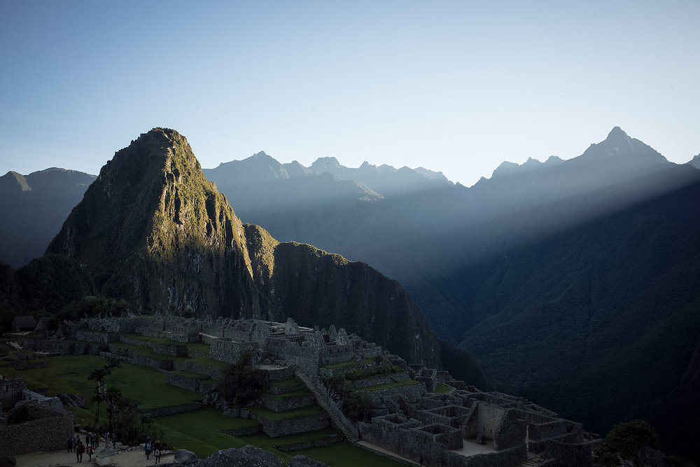 Sunrise strikes the top of Wayna Picchu.