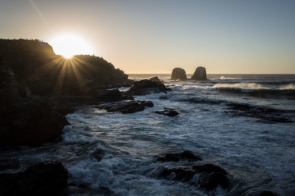 Sunset at the point in Punta de Lobos, a popular surf destination in central Chile.