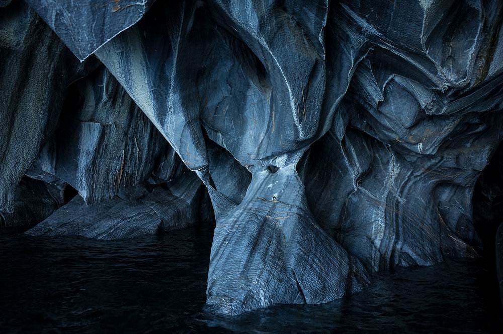 Marble formations in one of the famous marble caves around Lake General Carrera.  The lake's uncanny blue waters reflect on the organic shapes and patterns of the marble, making for spectacular images.