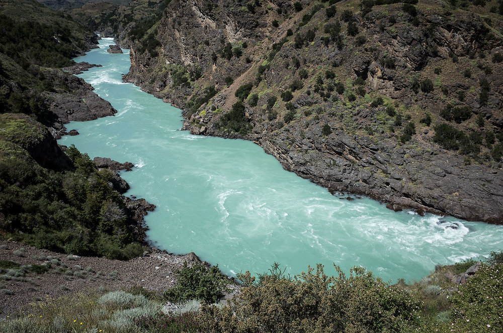 Río Baker in central Patagonia is Chile's largest river by volume.  It is fed by glaciers of the Northern Patagonia Ice Field, the sediment of which christens the river with its bright turquoise hue.