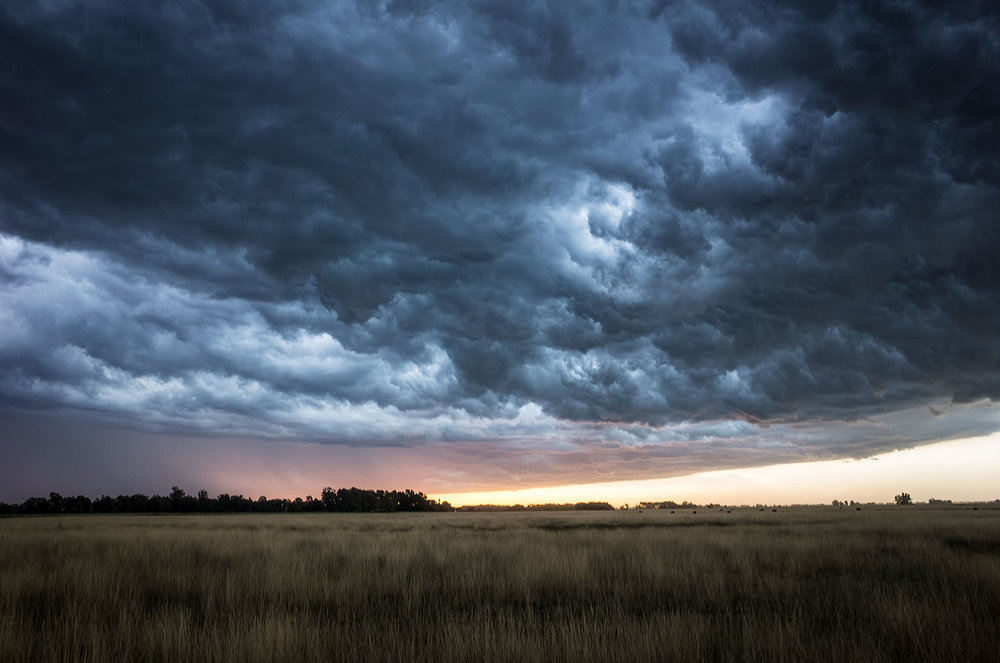 An electrical storm crosses the sky at sunset on the plains of central Argentina.