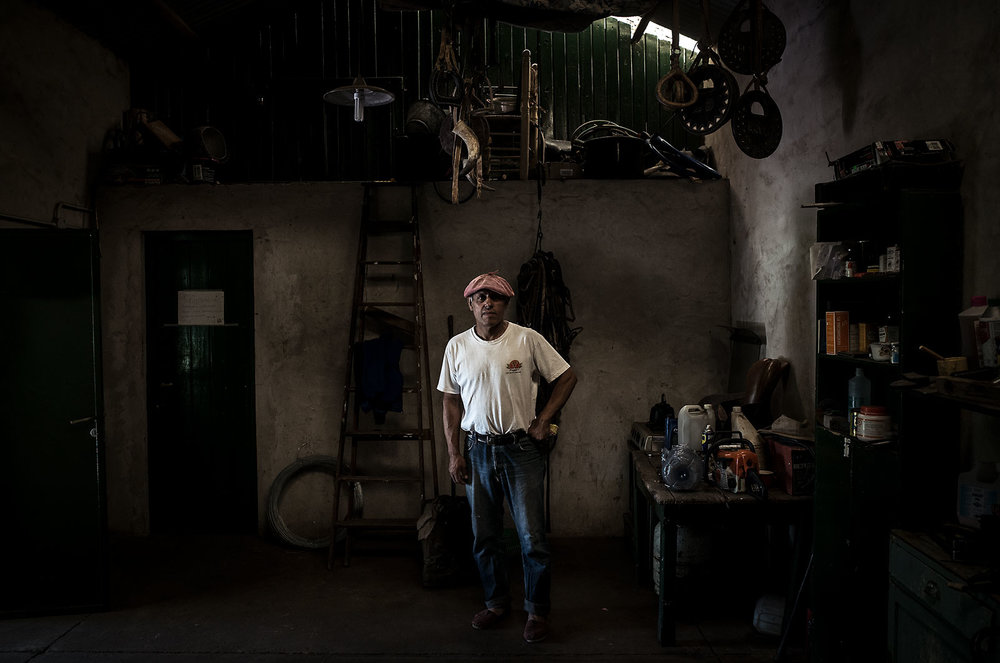 A gaucho poses in one of the tool sheds on the property where he works, home to 150 horses raised exclusively for polo.  Daniel, the son of a gaucho, has worked with horses his whole life.  His two sons, twins, are gauchos as well.