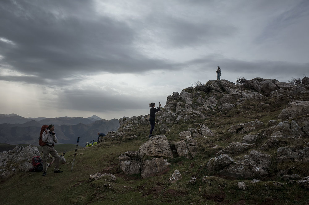 A pilgrim takes a photo of a statue of the Virgin along the way in the Pyrenees.