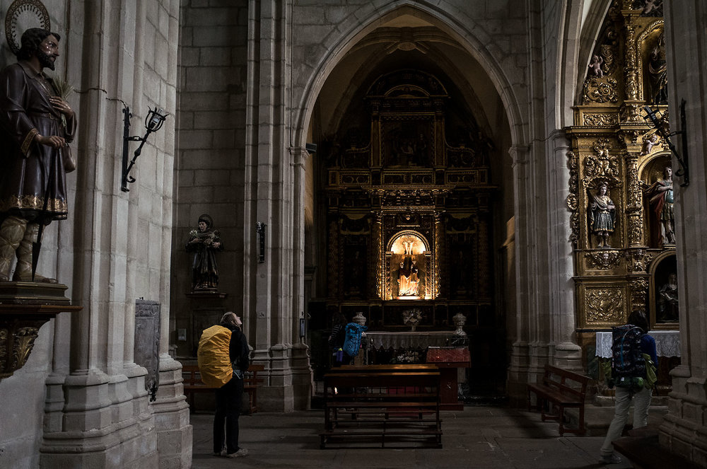 Though the modern Camino has become more secular in its attraction, its Catholic origins remain evident. Seemingly every village along the way no matter how small has at least one and often multiple churches. Some are mere empty stone huts with little more than a cross; others full cathedrals with huge Renaissance paintings and gilded Baroque altars.