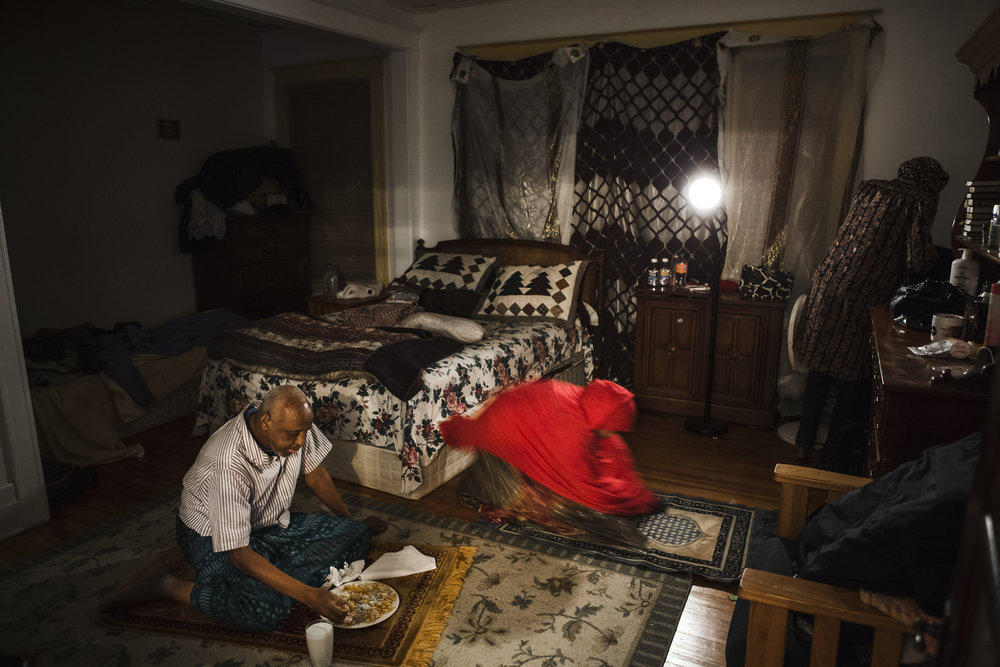 "Abdul Rahman eats a traditional Somali dinner after completing his Maghrib prayer, while Najma performs the same prayer, with Aliya occupied in the corner. Maghrib, literally ""sunset"" in Arabic, is the fourth prayer that practicing Muslims are required to perform; there are 5 in total. More often than not, Abdul Rahman eats dinner directly on his prayer mat after performing Maghrib. Dec 2, 2016"