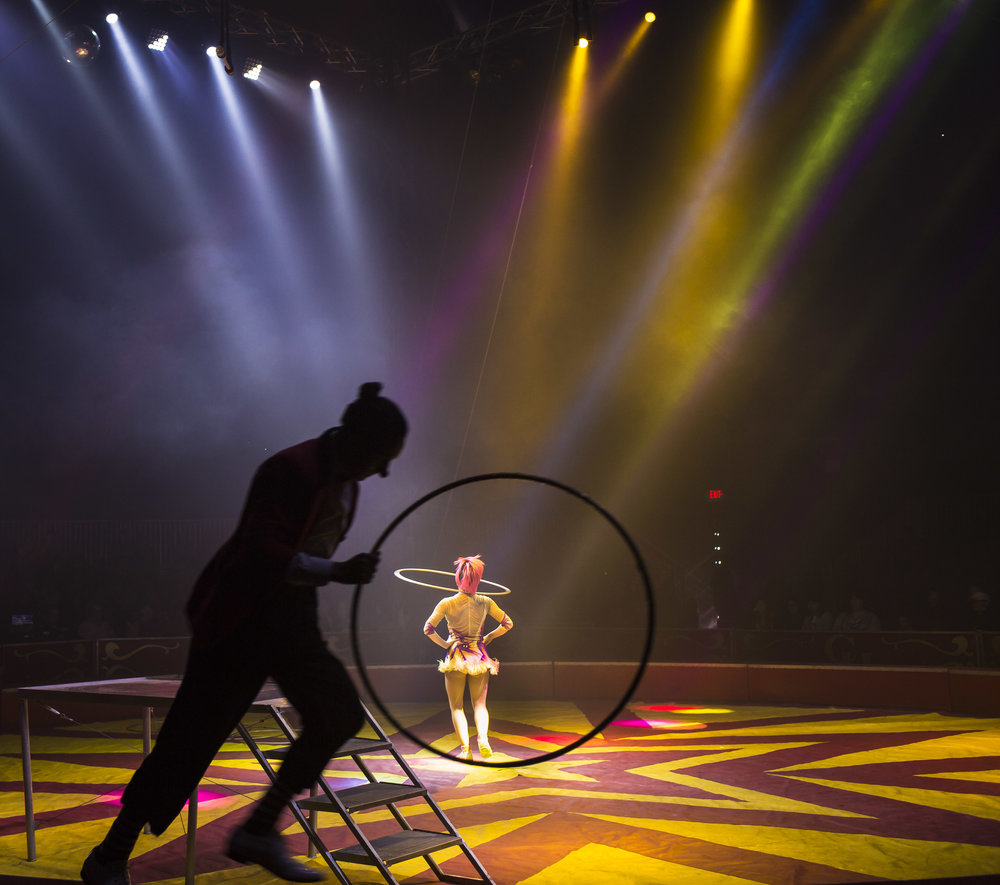 Crystal Coronas performs her opening hula hoop act as Cristhian Videla runs along the ring edge during a Coronas of Hollywood circus show at The Great New York State Fair in Syracuse, NY, Sept. 3, 2017.    View this Photo Story