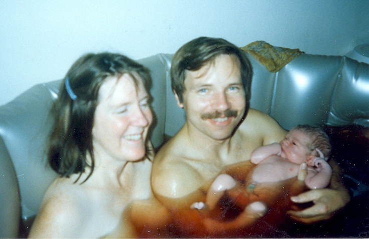 Natural birth of our son, underwater, at home, in the dining room. Our three daughters following can truthfully boast, I was born in the kitchen..jpg