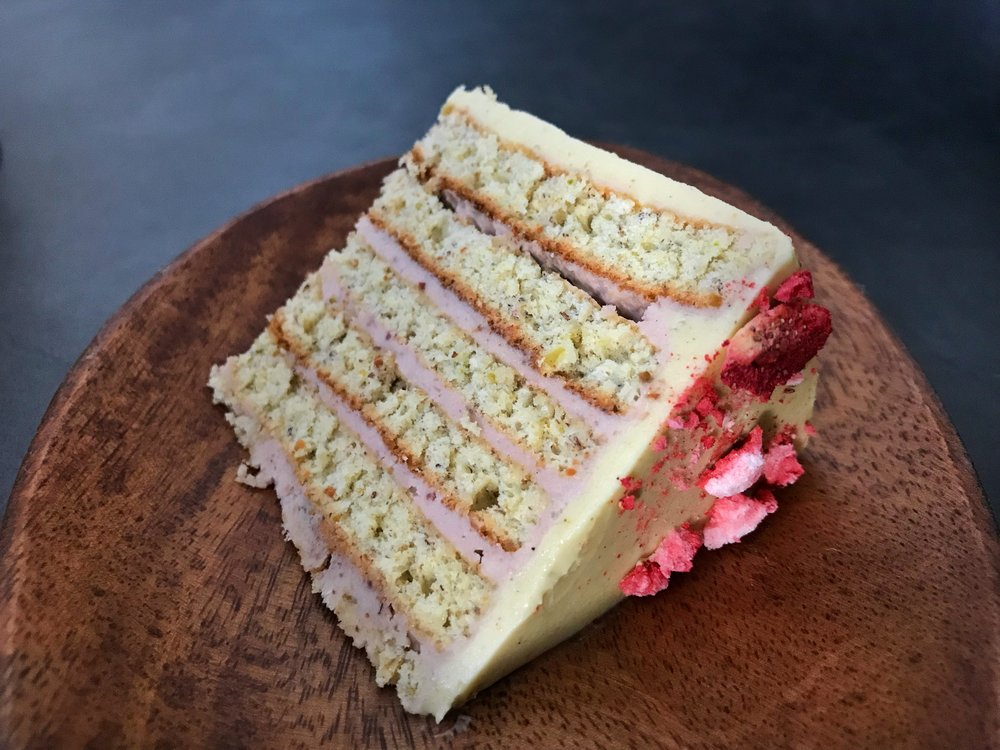 strawberry-pistachio-buttercream-roulade-cake-slice