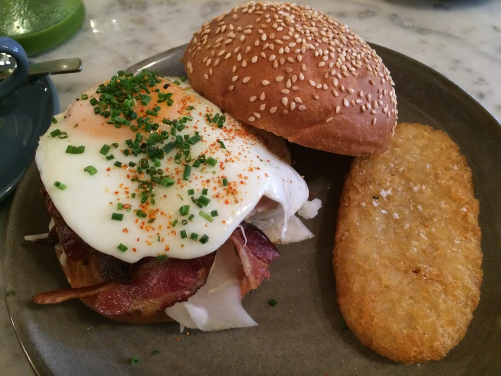 The Merchant: Chilli Fried Egg, Crispy Bacon, Ranch Dressing & Pickled Slaw on a warm brioche bun. Plus a hash brown