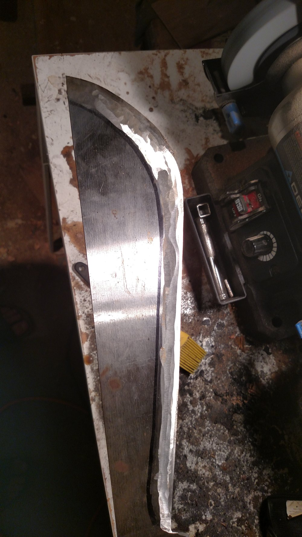 I shaped the blade from a piece of O2 bar stock I ordered from McMaster Carr.