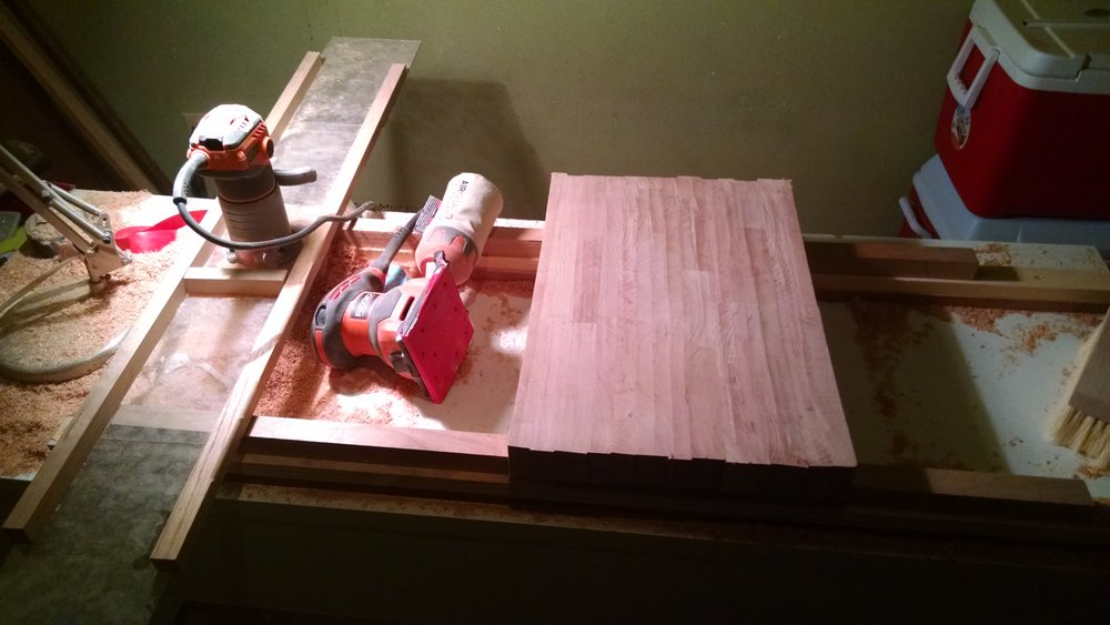 Using my homemade router jig to flatten a cherry cutting board.