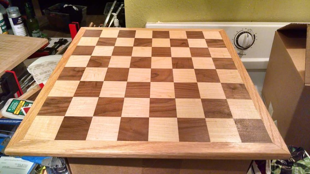 This board was a wedding present for my friend Emmanuel. He and his husband liked to play chess and Go. So I made a board with chess on one side...