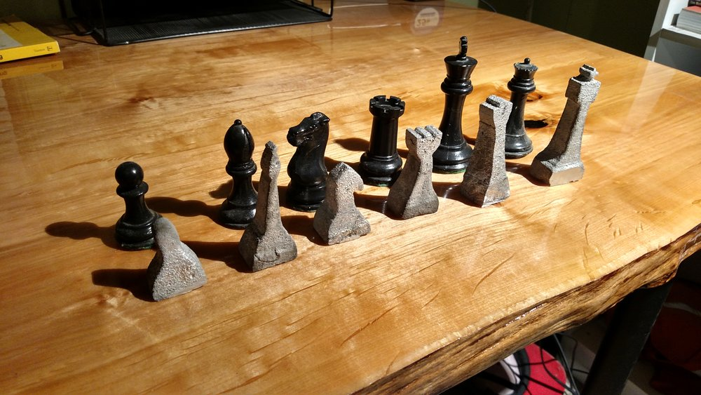 Details of the rough cast Aluminum chess pieces as compared to the cast concrete set.