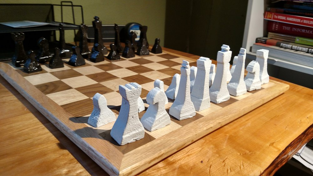 I cast this chess set out of aluminum. More pictures of the casting process can be found on my metal working  page .
