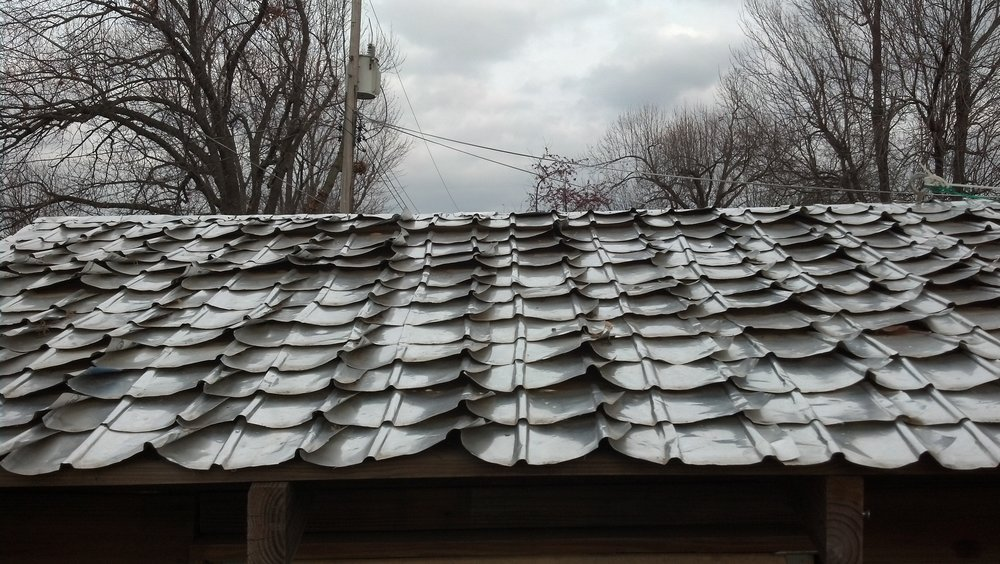 I made a forming jig to make old aluminum cans into shingles. It took forever and was probably not worth the time.