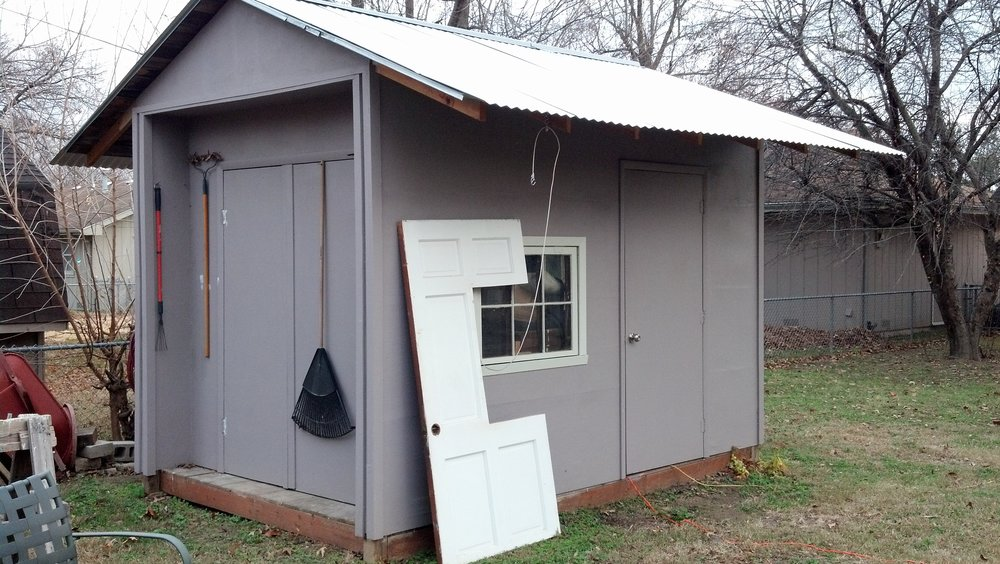 A shed that I built with my dad and brothers. It is inches under the size that would require a permit.