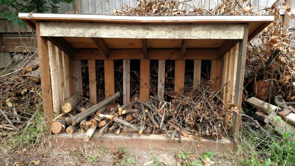 I did end up buying shingles, nails and metal edging to finish up the woodshed.